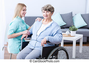 Physiotherapist rehabilitating senior woman