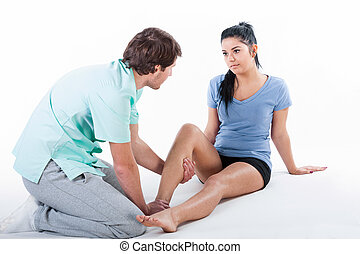 Physiotherapist training with patient