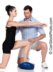 Physiotherapist treating patient - Adult male...