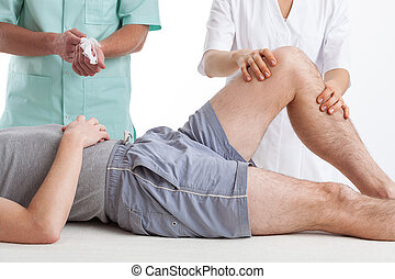 Man with leg problems is on physiotherapy intervention