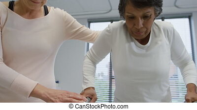 Physiotherapy session at a hospital - Front view close up of...