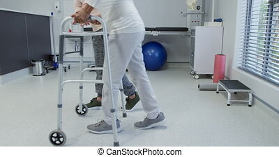 Physiotherapy session at a hospital - Side view low section...