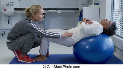 Physiotherapy session at a hospital - Side view of a...