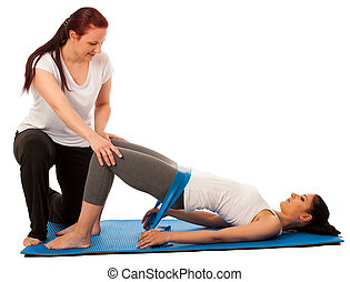 Physiotherapy - therapist doing   excercises with band for improving back strenght and stability with a patient to recover  after injury isolated