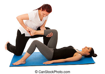 Physiotherapy - therapist doing   leg stretching excercises with a patient to recover  after injury isolated