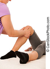 physiotherapy -therapist excercising with patient , working on leg stretching