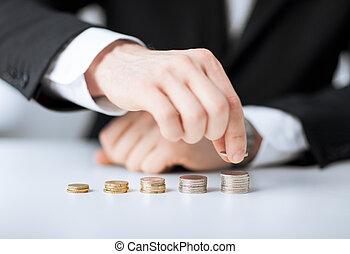 pièces, une, mettre, homme, pile, rang