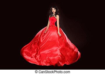 piękna kobieta, chodząc, w, wspaniały, czerwony strój, odizolowany, na, czarnoskóry, tło., studio, photo., fashion.