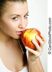 piękna kobieta, jedzenie jabłko, młody, czerwony