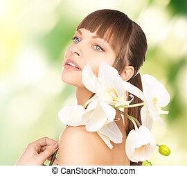 piękna kobieta, kwiat, storczyk