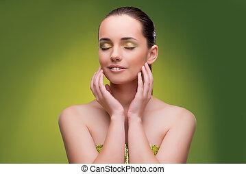 piękna kobieta, na, zielone tło