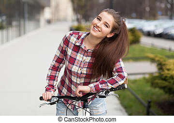 piękna kobieta, rower, młody