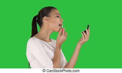 piękna kobieta, szminka, chroma, młody, ekran, kładzenie, key., zielony