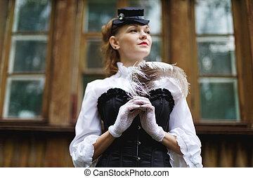 piękna kobieta, ubrany, w, retro, wiktoriański styl