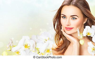 piękno, kobieta, z, storczyk, flowers., piękny, zdrój, dziewczyna, dotykanie, jej, twarz