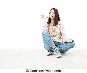 piękny, dziewczyna, nastolatek, myślenie, posiedzenie na podłodze