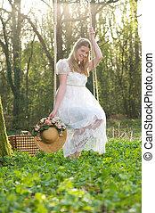 piękny, młoda kobieta, posiedzenie, na, niejaki, huśtać się, outdoors