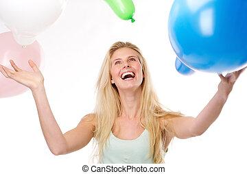 piękny, młoda kobieta, uśmiechanie się, z, balony