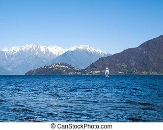 Windsurfer sailing on the lake