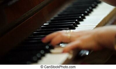 Pianist - A woman plays the piano.