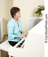 Pianist Playing Church Hymns - Pianist playing hymns on the...