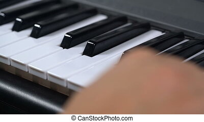 pianist plays the piano, close up