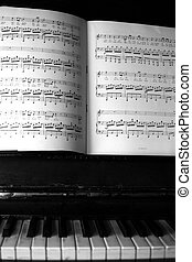 Piano and old notes - The keyboard of the piano and old...