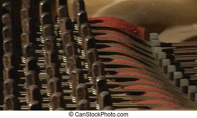 piano damper cu pan - This is a close up panning shot of the...