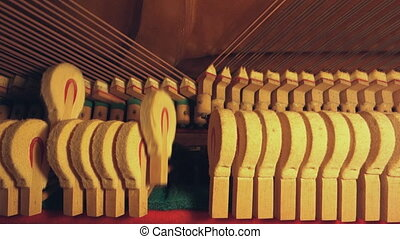 piano hammer - inside piano, hammer hitting strings