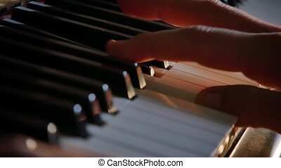 Piano hand playing, France