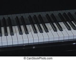 piano aka Pianoforte keyboard music instrument - detail of the keyboard