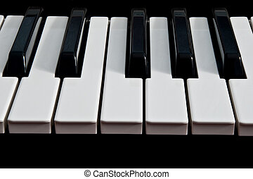 piano keyboard isolated on black background