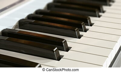 Piano keyboard - Macro view of piano keyboard with selective...