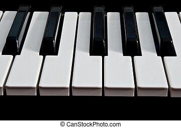 piano keyboard isolated on black background