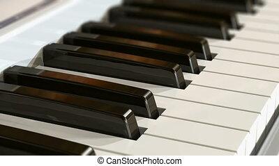 Piano keyboard - Macro view of piano keyboard with selective...