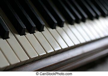 Piano Keys - A closeup of the keys of a piano, shot with...