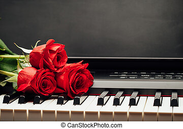 piano keys and red rose with copy-space