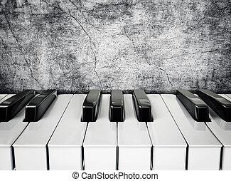 piano keys - black and white piano keys on a stucco wall