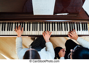 piano lesson at a music school - piano lesson at a music...
