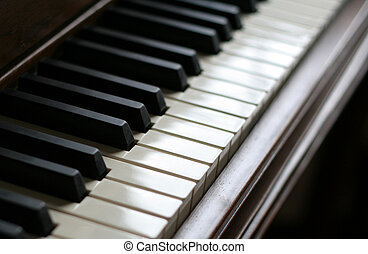 Piano Peace - A closeup of the keys of a piano, shot with...