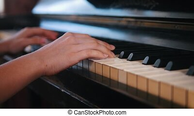 Piano playing - close up shot - teen girl hands