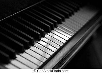 Piano Reflections - A closeup of the keys of a piano, shot...