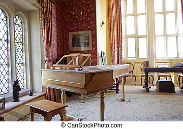 piano room - piano in an old style room in country house