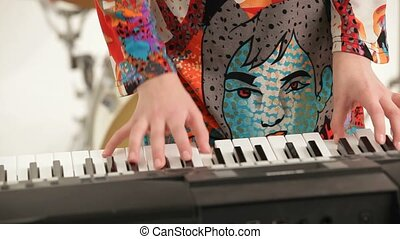 Piano Soloist - Young woman playing piano. Rehearsal musical...