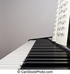 piano with music sheet