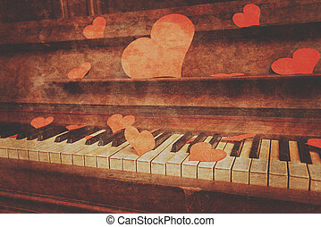 Piano with paper hearts