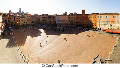 Panoramic on the Piazza del Campo in Siena, Italy, on a summer afternoon