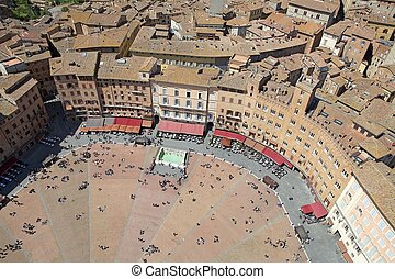 Piazza del Campo view. Piazza del Campo is the principal public space of the historic centre of Siena, Tuscany, Italy. The mansions that line the shell-shaped square have unified the rooflines. The twice a year horse race, Palio di Siena, is held around the edges of the square. The open site was a ...