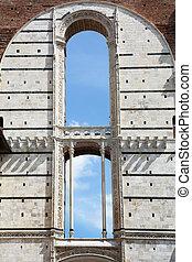 a facade at the Piazza del Duomo in Siena, Italy