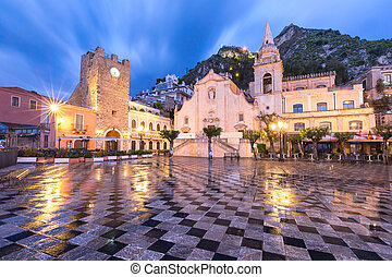 Belvedere of Taormina and San Giuseppe church on the square Piazza IX Aprile in Taormina at rainy night, Sicily, Italy